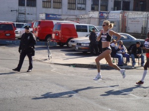 Paula Radcliffe airborne at mile 14 in the New York marathon, 2007.  Photo by Ed Costello, Brooklyn, NY,US